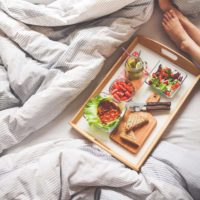 young-woman-enjoying-morning-breakfast-in-bed-picjumbo-com copy